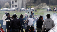 Pictured: A fight breaks out between migrants Tuesday 08 March 2016<br /> Re: Heavy overnight rain has flooded the migrant camp at the Greek FYRO Macedonian border of Idomeni in Greece