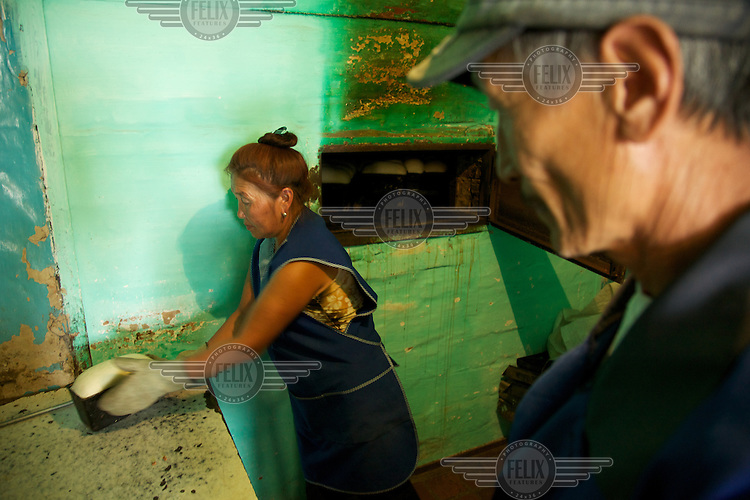 Entrepreneur Boris Badu oversees the baking of bread at his factory in Chodura Village, Tuva Republic, southern Siberia, Russia. His factory, employing six people, supplies bread to a big town nearby and is the only factory in the poor village.