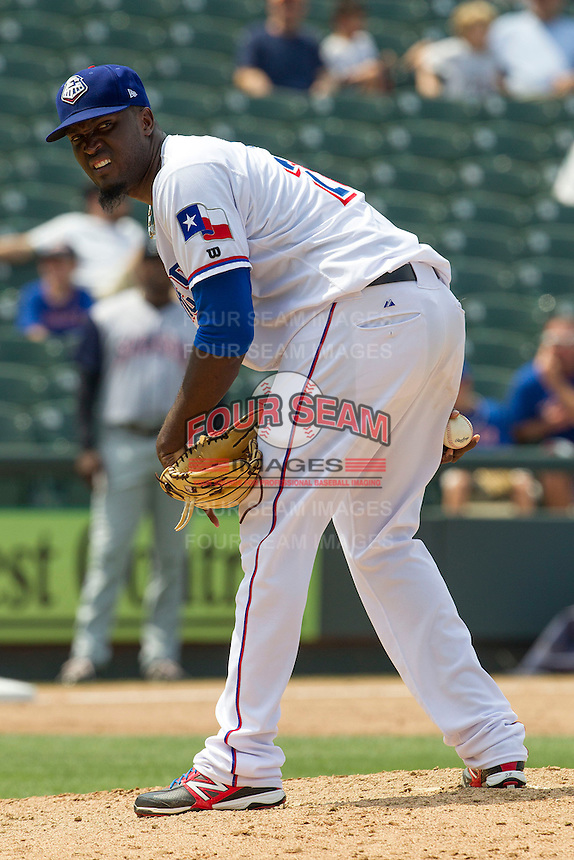 Round Rock Express pitcher Johan Yan (28) looks towards a runner on first base against the Colorado Springs Sky Sox in the Pacific Coast League baseball game on May 19, 2013 at the Dell Diamond in Round Rock, Texas. Colorado Springs defeated Round Rock 3-1 in 10 innings. (Andrew Woolley/Four Seam Images).