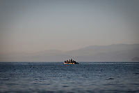 CEUTA, SPAIN ‐ MAY 19: A boat with a group of young people try to swim across the border from Morocco to Spain, bordering the Tarajal beach while two soldiers of the Spanish army wait for them to land to be returned to Morocco on May 19, 2021 in Ceuta, Spain.  After a diplomatic conflict between Spain and Morocco, thousands of migrants who have taken advantage of the little Moroccan police activity on the border to cross it mainly by swimming, which has caused a migration crisis with the entry of more than 8000 migrants from the African country. (Photo by Joan Amengual/VIEWpress )