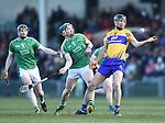 Cathal Malone of  Clare  in action against Sean Finn of  Limerick during their NHL quarter final at the Gaelic Grounds. Photograph by John Kelly.