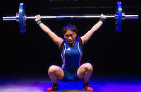 10 MAY 2014 - COVENTRY, GBR - Poy Fakcha from Crystal Palace Weightlifting Club attempts to complete a lift during the women's 58kg category round at the British 2014 Senior Weightlifting Championships and final 2014 Commonwealth Games qualifying event round at the Ricoh Arena in Coventry, Great Britain (PHOTO COPYRIGHT © 2014 NIGEL FARROW, ALL RIGHTS RESERVED)