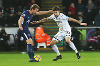Harry Kane of Tottenham Hotspur is challenged by Federico Fernandez of Swansea City during the Premier League match between Swansea City and Tottenham Hotspur at the Liberty Stadium, Swansea, Wales, UK. Tuesday 02 January 2018