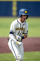 Michigan Wolverines second baseman Ted Burton (3) celebrates scoring a run against the Maryland Terrapins on May 23, 2021 in NCAA baseball action at Ray Fisher Stadium in Ann Arbor, Michigan. Maryland beat the Wolverines 7-3. (Andrew Woolley/Four Seam Images)