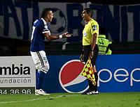 BOGOTA - COLOMBIA - 18 – 02 - 2018: Juan Guillermo Dominguez (Izq.) jugador de Millonarios discute con Humberto Clavijo (Der.), Asistente No. 1,  durante partido de la fecha 4 entre Millonarios y por la Liga Aguila I 2018, jugado en el estadio Nemesio Camacho El Campin de la ciudad de Bogota. / Juan Guillermo Dominguez (R) player of Millonarios discuss with Humberto Clavijo (Der.), Assistant No. 1, during a match of the 4th date between Millonarios and Atletico Nacional, for the Liga Aguila I 2018 played at the Nemesio Camacho El Campin Stadium in Bogota city, Photo: VizzorImage / Luis Ramirez / Staff.