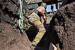 UKRAINE, Pisky: Daniel, 19 years old who's in in the 93 brigade starts his shift at his position in one of the tranches of Pisky frontline. While observing a sniper position of the separatist, shooting started between the two trenches. <br /> <br /> UKRAINE, Pisky: Daniel, 19 ans, qui est dans la brigade 93 commence son quart de travail à son poste dans l'une des tranchées de première ligne Pisky. Tout en observant une position de sniper de l'séparatiste, tirs ont commencé entre les deux tranchées.