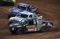 Mar. 20, 2011; Chandler, AZ, USA;  LOORRS pro two driver Brian Deegan (38) leads Carl Renezeder and Bryce Menzies during round two at Firebird International Raceway. Mandatory Credit: Mark J. Rebilas-