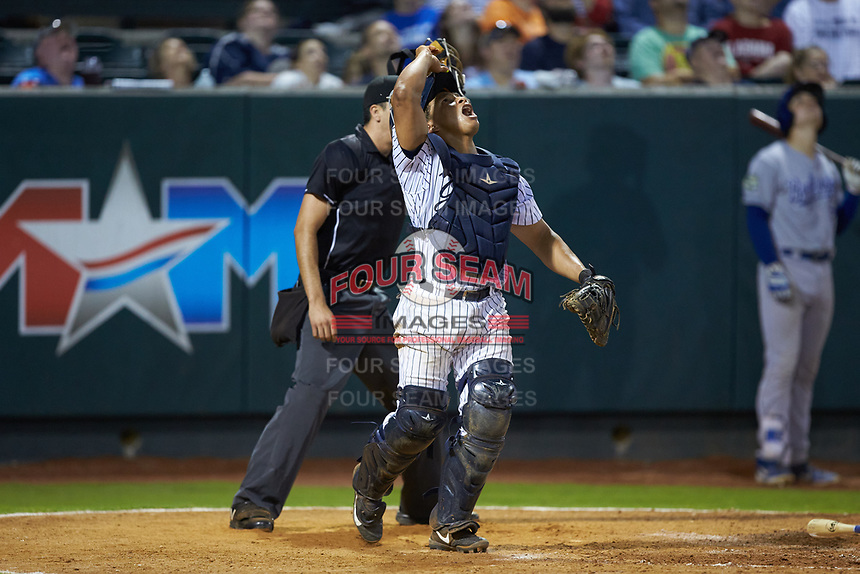 Pulaski Yankees catcher Gustavo Campero (24) tracks a pop fly during the game against the Burlington Royals at Calfee Park on August 31, 2019 in Pulaski, Virginia. The Yankees defeated the Royals 6-0. (Brian Westerholt/Four Seam Images)