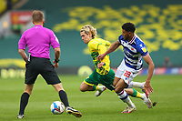 1st May 2021; Carrow Road, Norwich, Norfolk, England, English Football League Championship Football, Norwich versus Reading; Todd Cantwell of Norwich City competes for the ball with Josh Laurent of Reading