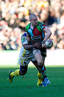 Mike Brown of Harlequins offloads in the tackle during the Heineken Cup Round 5 match between Harlequins and ASM Clermont Auvergne at the Twickenham Stoop on Saturday 11th January 2014 (Photo by Rob Munro)