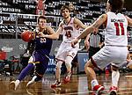 SIOUX FALLS, SD - MARCH 6: Colton Sandage #20 of the Western Illinois Leathernecks gets a step past Brady Heiman #45 of the South Dakota Coyotes during the Summit League Basketball Tournament at the Sanford Pentagon in Sioux Falls, SD. (Photo by Dave Eggen/Inertia)