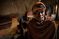 "Jawahir a recent arrival to Statehouse IDP camp. She fled Mogadishu after her husband and 3 of her children were killed. She went first to Afgooye- an IDP camp near mogadishu. Then she made the perilous journey by road to Hargeysa.."" In Afgooye there  was a big problem. there was little water and very little food. There's no help. We had only Hargeysa in our minds. We came seeking peace and (here) we found it..According to OXFAM almost half of  Somalia's population- 3.2 million people are in need of emergency aid. Over a million people have  been  forced to flee thier homes. The delivery of aid is also extremely challenging today in  Somalia ""Aid agencies are able to provide only a fraction of the assistance needed because of extreme violence and the trageting of aid workers. 37 aid workers were killed trying to do thier jobs since the start of 2008."""
