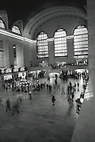 Overhead view of travelers in motion in the interior of Grand Central Station. New York..