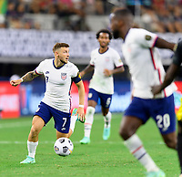 DALLAS, TX - JULY 25: Paul Arriola #7 of the United States looks to pass the ball during a game between Jamaica and USMNT at AT&T Stadium on July 25, 2021 in Dallas, Texas.