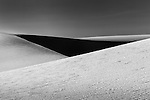Black and white abstract of white sand dunes