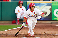 Kolten Wong (4) of the Springfield Cardinals runs to first base during a game against the Northwest Arkansas Naturals at Hammons Field on June 14, 2012 in Springfield, Missouri. (David Welker/Four Seam Images)