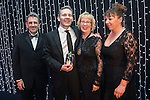 © Joel Goodman - 07973 332324 . 05/03/2015 .  Midland Hotel , Manchester , UK . L-R Eamonn O'Neill , winner Matthew Claughton ( Olliers Solicitors ) , Louise Straw and sponsor ( The Law Society ). Partner of the Year . The Manchester Legal Awards 2015 . Photo credit : Joel Goodman