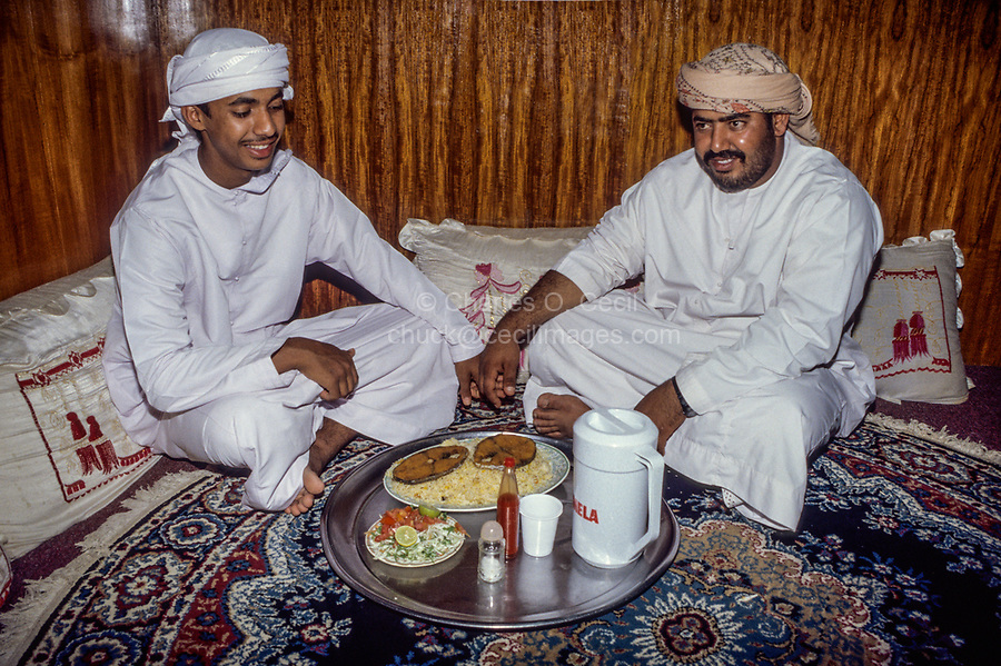 Nizwa, Oman.  Sitting on the floor in an Omani restaurant for lunch of fish, rice, and salad.