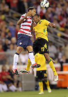 COLUMBUS, OHIO - SEPTEMBER 11, 2012:  Jermaine Jones (13) of the USA MNT wins a header from Rodolph Austin (17) of  Jamaica during a CONCACAF 2014 World Cup qualifying  match at Crew Stadium, in Columbus, Ohio on September 11. USA won 1-0.