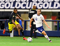 DALLAS, TX - JULY 25: James Sands #16 of the United States looks to pass the ball in front of Cory Burke #9 of Jamaica during a game between Jamaica and USMNT at AT&T Stadium on July 25, 2021 in Dallas, Texas.