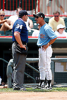 June 25, 2009:  Manager Tom Brookens of the Erie Seawolves argues a balk call with home plate Johnny Conrad after being ejected during a game at Jerry Uht Park in Erie, PA.  The Erie Seawolves are the Eastern League Double-A affiliate of the Detroit Tigers.  Photo by:  Mike Janes/Four Seam Images