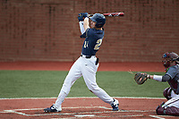 Ricky Clark (24) of the Wingate Bulldogs follows through on a home run against the Concord Mountain Lions at Ron Christopher Stadium on February 1, 2020 in Wingate, North Carolina. The Bulldogs defeated the Mountain Lions 8-0 in game one of a doubleheader. (Brian Westerholt/Four Seam Images)