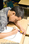Education Elementary Public Grade 2 student drawing boy at work vertical