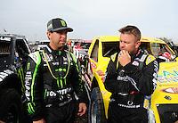 Mar. 20, 2011; Chandler, AZ, USA;  LOORRS pro two driver Jeremy McGrath (left) talks with Rob Naughton during round two at Firebird International Raceway. Mandatory Credit: Mark J. Rebilas-