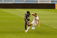 ST PAUL, MN - SEPTEMBER 06: Romain Metanire #19 of Minnesota United FC and Tate Schmitt #21 of Real Salt Lake battle for the ball during a game between Real Salt Lake and Minnesota United FC at Allianz Field on September 06, 2020 in St Paul, Minnesota.