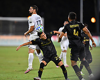 LAKE BUENA VISTA, FL - JULY 18: Eduard Atuesta #20 of LAFC heads the ball while pressured by Sebastian Lletget #17 of LA Galaxy during a game between Los Angeles Galaxy and Los Angeles FC at ESPN Wide World of Sports on July 18, 2020 in Lake Buena Vista, Florida.