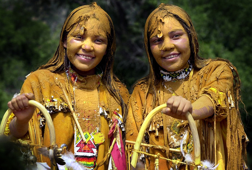 """SUNRISE CEREMONY Pollen-covered Fayreen and Farren are all smiles at their coming of age ceremony...Twelve year old Fayreen and Farren Holden, identical twins born 6 minutes apart, celebrated their coming of age last weekend with a four-day Apache Sunrise Ceremony.This age old ceremony initates young Apache women in to womenhood and prepares them for the long journey through life. The Double Ceremony was sponsored by mom, Joycelyn Holden and Nathaniel and Denise Cosay.Sunrise ceremonies are held on both the White Mountain and San Carlos Apache Reservations beginning in May and carry through into the fall each year and the ceremony is the """"coming of age"""" puberty rite which has been celebrated by the Apache for centuries....."""