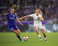 Orlando, FL - Saturday March 24, 2018: Utah Royals forward Brittany Ratcliffe (25) is pressured by Orlando Pride midfielder Dani Weatherholt (17) during a regular season National Women's Soccer League (NWSL) match between the Orlando Pride and the Utah Royals FC at Orlando City Stadium. The game ended in a 1-1 draw.