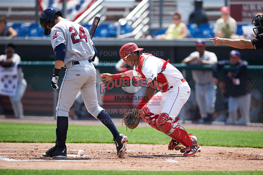 Auburn Doubledays catcher Jeyner Baez (13) retrieves the ball after blocking a pitch with Ernie Clement (24) batting during the first game of a doubleheader against the Mahoning Valley Scrappers on July 2, 2017 at Falcon Park in Auburn, New York.  Mahoning Valley defeated Auburn 3-0.  (Mike Janes/Four Seam Images)