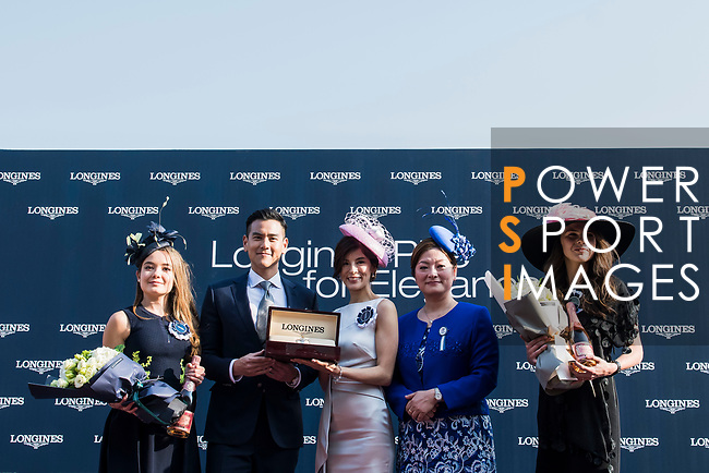 Eddie Peng (2nd from left), Longines Ambassador of Elegance, and Karen Au-Yeung (2nd from right), vice President of LONGINES Hong Kong, attend the Longines Prize for Elegances Presentation during the Longines Hong Kong International Races at Sha Tin Racecourse on December 10 2017, in Hong Kong, Hong Kong. Photo by Victor Fraile / Power Sport Images