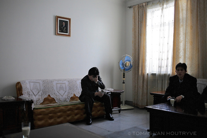 A North Korean factory director holds his head during a visit by foreign visitors in Pyongyang, North Korea (DPRK) on 27 February 2008.