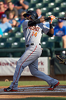 Fresno Grizzlies outfielder Francisco Peguero #14 swings during the Pacific Coast League baseball game against the Round Rock Express on May 19, 2012 at The Dell Diamond in Round Rock, Texas. The Grizzlies defeated the Express 10-4. (Andrew Woolley/Four Seam Images)