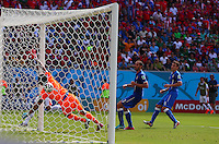 The header of Bryan Ruiz of Costa Rica (hidden) crosses the line after hitting the crossbar for the opening goal, 1-0