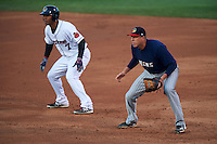 Toledo Mudhens first baseman Mike Hessman (27) holds Wilkin Ramirez (7) during a game against the Rochester Red Wings on May 12, 2015 at Frontier Field in Rochester, New York.  Toledo defeated Rochester 8-0.  (Mike Janes/Four Seam Images)