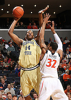 Georgia Tech's Derrick Favors(14) is defended by Virginia's Mike Scott(32)during an ACC college basketball game Wednesday Jan. 13, 2010 in Charlottesville, Va.  (Photo/Andrew Shurtleff)