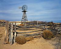 Windmill, corral, and tumbleweeks on a ranch near Socorro, NM