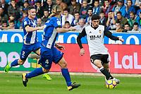 Deportivo Alaves' Carlos Vigaray (l) and Alexis Ruano (r) and Valencia CF's Gonzalo Guedes during La Liga match. October 28,2017. (ALTERPHOTOS/Acero) /NortePhoto.com