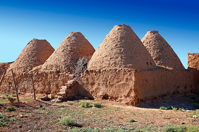 """Pictures of the beehive adobe buildings of Harran, south west Anatolia, Turkey.  Harran was a major ancient city in Upper Mesopotamia whose site is near the modern village of Altınbaşak, Turkey, 24 miles (44 kilometers) southeast of Şanlıurfa. The location is in a district of Şanlıurfa Province that is also named """"Harran"""". Harran is famous for its traditional 'beehive' adobe houses, constructed entirely without wood. The design of these makes them cool inside. 9"""