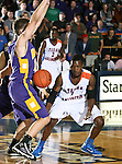 Hardin-Simmons Cowboys forward Ryan Carlson (11) loses the ball as Texas-Arlington Mavericks forward Bo Ingram (1) watches in the game between the UTA Mavericks and the Hardin-Simmons Cowboys held at the University of Texas in Arlington's Texas Hall in Arlington, Texas. UTA defeats Hardin-Simmons 88 to 71.