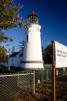 A view of the northwest side of the Umpqua River Lighthouse at Winchester Bay on the Oregon coast.  Although it sits in a state park, the lighthouse and museum are operated by the Douglas County Parks Department.  The lighthouse and its beacon are maintained by the US Coast Guard who have living quarters on the grounds surrounding the lighthouse.
