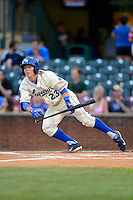 Lexington Legends outfielder Ethan Chapman #23 lays down a bunt during a game against the Greenville Drive on April 18, 2013 at Whitaker Bank Ballpark in Lexington, Kentucky.  Lexington defeated Greenville 12-3.  (Mike Janes/Four Seam Images)