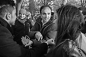 Speakers' Corner, Hyde Park, London.  A man uses his smartphone to show a video of bombing damage in Gaza to an Israeli tourist.
