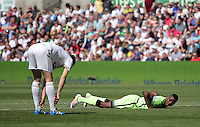 Kelechi Iheanacho of Manchester City on the ground after his shot went wide during the Swansea City FC v Manchester City Premier League game at the Liberty Stadium, Swansea, Wales, UK, Sunday 15 May 2016