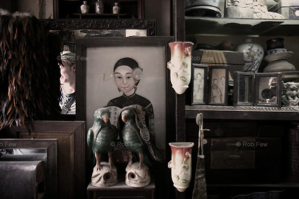 Antique shop in a Beijing hutong with me photographing my friend.