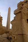 This obelisk is made from pink granite from the quarries at Aswan it is 65 feet high and weighs 143 tons and was raised by Queen Hatshepsut's father Thutmosis I who ruled Egypt from 1506 -1493 BC (disputed).Originally the obelisk had the top encased in electrum, a mixture of gold and silver. Karnak is part of the ancient city of Thebes ( built in and around modern day Luxor).The building of the Temple complex at Karnak began in the reign of the Pharaoh Senusret I who ruled Egypt from 1971-1926 BC. Approximately 30 Pharaohs contributed to the building of the complex and in so doing made it the largest ancient religious site in the world. The ancient name for Karnak was Ipet-isut (Most select of places).