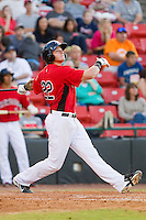 Joe Maloney (22) of the Hickory Crawdads follows through on his swing against the Kannapolis Intimidators at L.P. Frans Stadium on May 25, 2013 in Hickory, North Carolina.  The Crawdads defeated the Intimidators 14-3.  (Brian Westerholt/Four Seam Images)